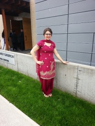 Standing outside the Toronto Buddhist Church in a traditional Indian suit.