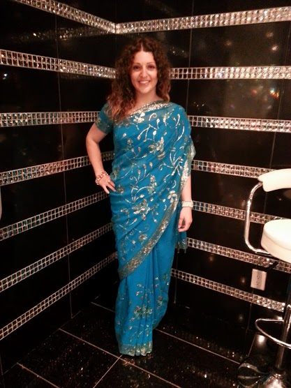 Wearing the sari I borrowed.