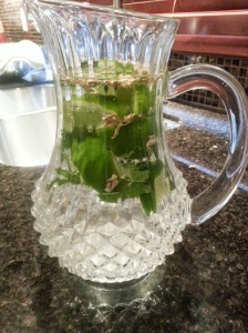 Water with sliced lime, mint leaves and ginger root.