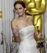 Jennifer Lawrence giving use to her middle finger at The Oscars.