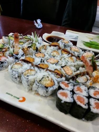 Spicy crab, spicy salmon, salmon, yam tempura and shrimp tempura rolls.