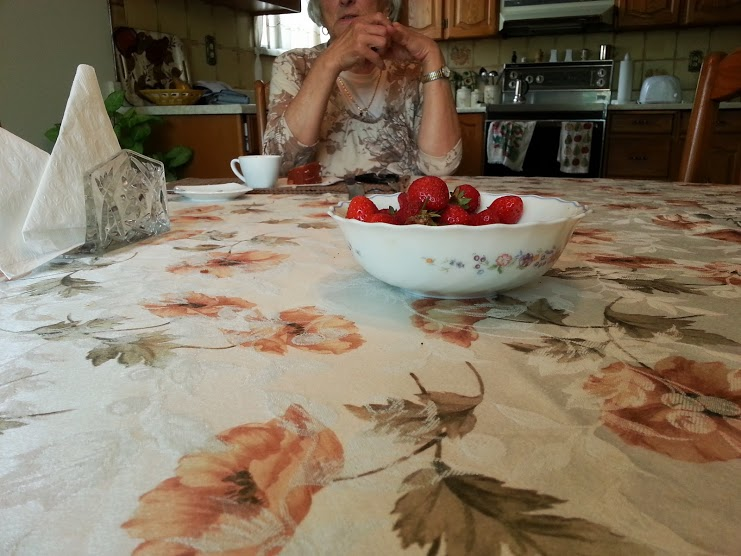 Trying Ontario strawberries for the first time this summer with my Grandmother.