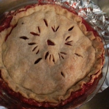 Momma's homemade strawberry rhubarb pie.