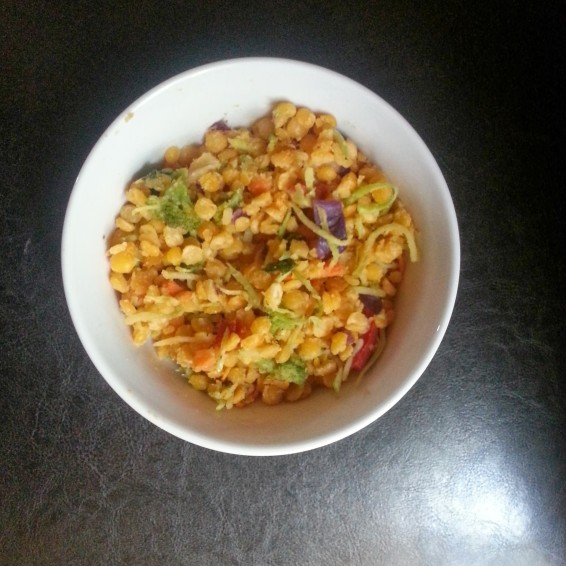 Yellow split pea salad with shredded broccoli, cabbage, carrots, mushrooms, hot pepper and kale.
