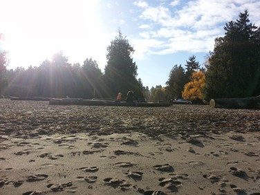 A mother and her child enjoying the morning sunshine at Jericho Beach.