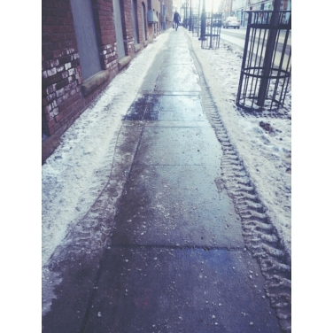 What the sidewalk on Richmond St W between John St and Spadina Ave in Toronto looks like when ploughed. Photo by: Leviana Coccia.
