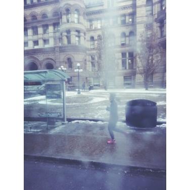 Running through a streetcar window smudge.