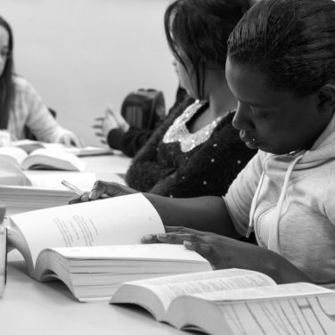 "In November 2013, at a reading circle called Women Moving Forward, the participants are reading ""Burned"" by Ellen Hopkins. Photo by Literature for Life volunteer photographer, Marie Andree Robert."