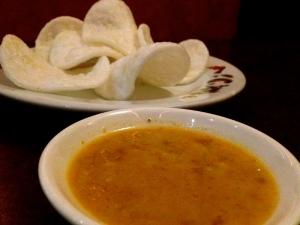 Fresh shrimp chips and warm peanut sauce at Thai Shan Inn.