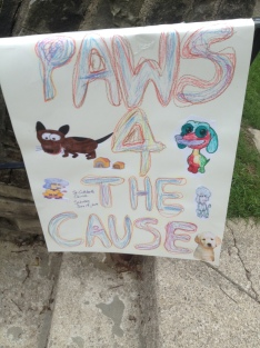 Homemade Paws for a Cause sign.