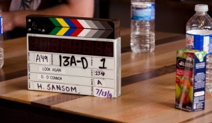 The clapboard set to scene 13A-D, take one.