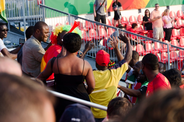 Chanting and dancing Team Ghana fans.