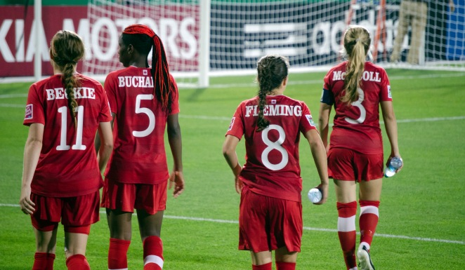 Janine Beckie, Kadeisha Buchanan, Jessie Fleming, and Kinley McNicoll walking back to the dressing room after the game vs Team Ghana.