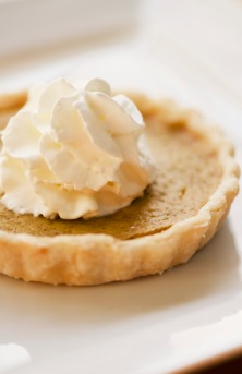 Nothing more festive for this time of year than a pumpkin pie tart with whipped cream.