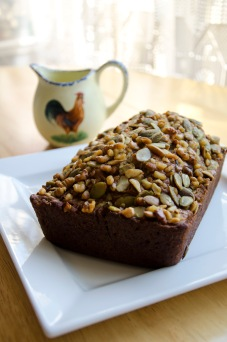 A delicious pumpkin loaf with a walnut and pumpkin seed crust.