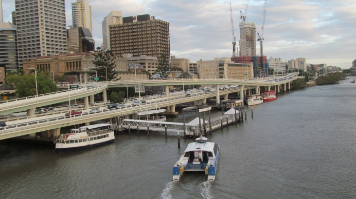A boat slowly approaches its dock on the Brisbane River. Photo by: Leviana Coccia.