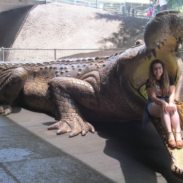 I sit in the mouth of a (thankfully) fake crocodile at The Australia Zoo. Photo by: Tessi Jimmink.