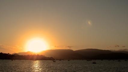 The sun sets in the Coral Sea. Photo by: Leviana Coccia.