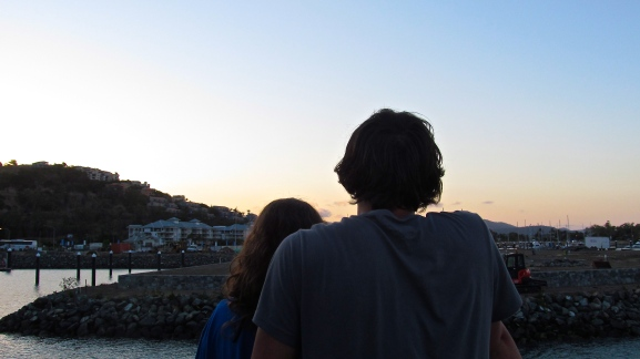 A couple from Sweden admires the Port of Airlie after a day at sea. Photo by: Leviana Coccia.