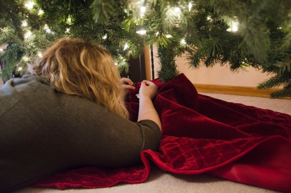Kate getting the felt fabric under the tree.