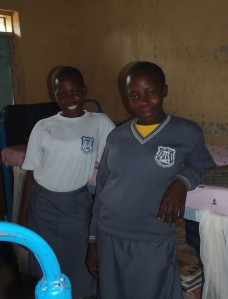 Aninga with her little sister who she sends to school with the pocket money we provide her. Courtesy of Jenny Benson.