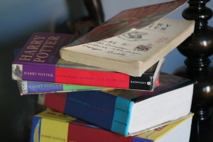 My stack of Harry Potter books, with an inscription that has since become priceless.