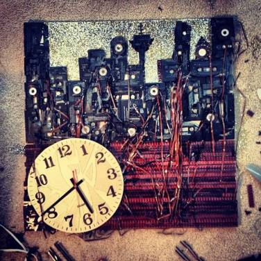 Cassette tapes/old film strips/glitter/broken clock.