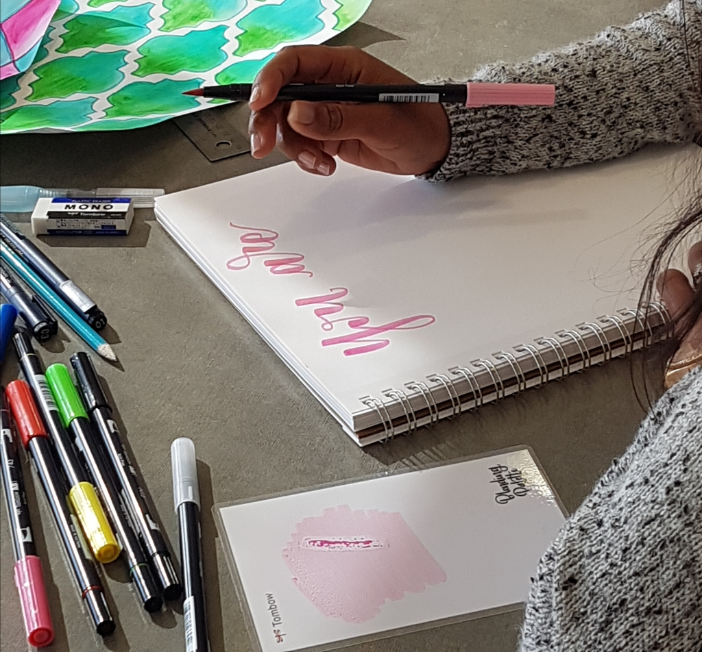 "Usha Rajpal Cheddi continues to craft the phrase, ""You are strong,"" using soft pink pen ink. Photo courtesy of: Usha Rajpal Cheddi."