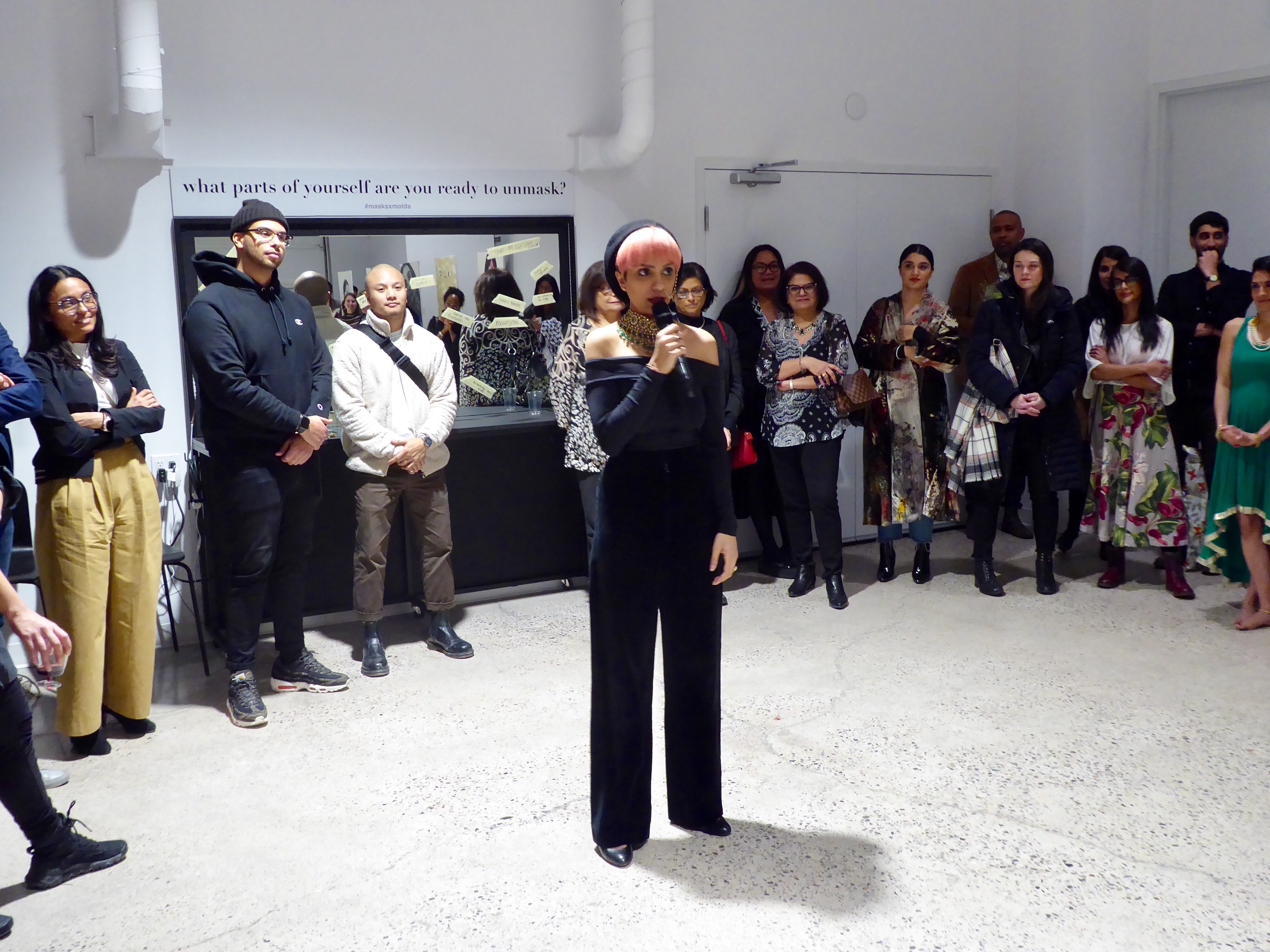 Romana Kassam presents at MasksxMolds, her first solo exhibition in Toronto. Photo by: Rejana Hirjee.