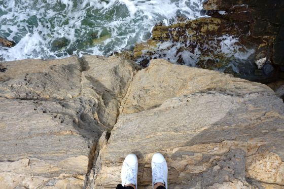 Shoes overlooking ocean